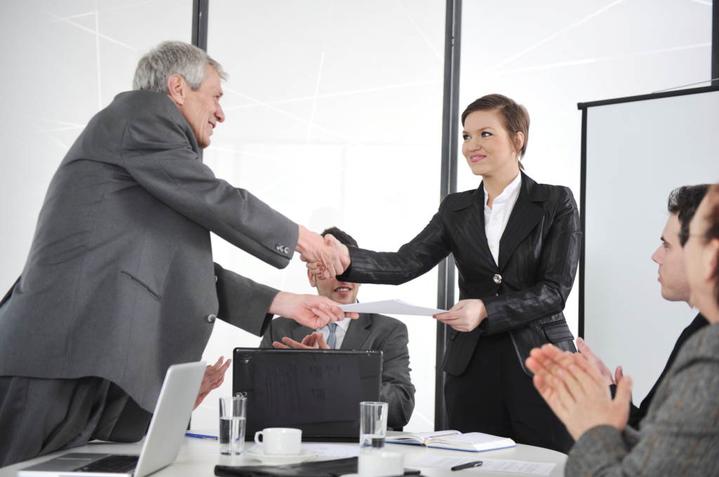 Kozzi-happy-business-leaders-handshaking-at-meeting-1776-X-1182